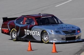 Michael Waltrip Racing development driver Trevor Bayne steers the new Toyota Nationwide COT