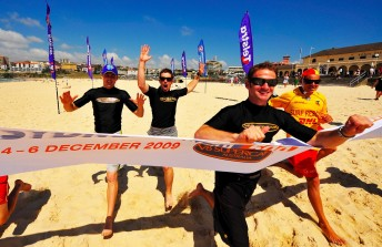Will Davison leads Mark Winterbottom and Tony D'Alberto across the line in a Bondi Beach sprint yesterday against some of Australia's best lifesavers