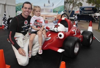 Craig Lowndes, a young fan and Roary
