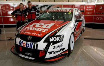 Will Davison and Garth Tander stand next to their 2010 Toll Holden Racing Team challenge
