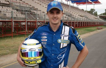 Mark Winterbottom poses with his new helmet design, featuring the colours of Monroe shock absorbers