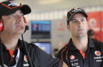 Roland Dane (foreground) with Jamie Whincup last weekend