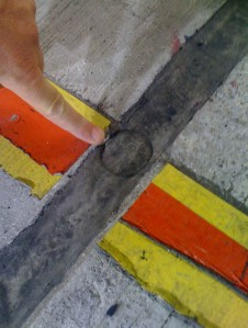 The silicon-filled expansion joint that the air jack on Tander's car 'fell' into