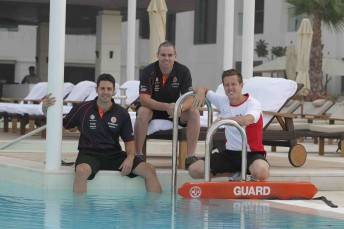 Jamie Whincup, James Courtney and Craig Lowndes chill out besides the pool in Abu Dhabi yesterday