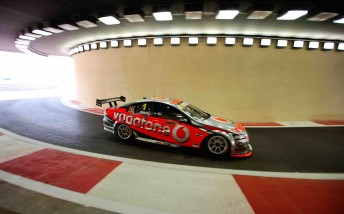 Jamie Whincup drives through the pit lane tunnel at the stunning Yas Marina Circuit