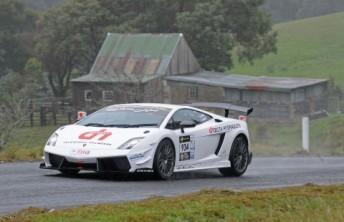 Jason White took charge despite the wet conditions at Targa Tasmania.