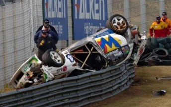 Simon Wills's Commodore ended up on the wrong side of the catch fence at Sandown Raceway in 2005
