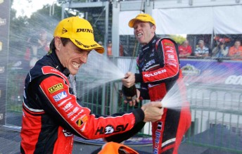 Cameron McConville celebrates victory on the streets of Surfers Paradise with co-driver Garth Tander