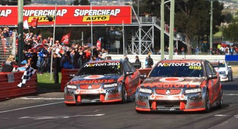 Craig Lowndes leads Jamie Whincup across the Bathurst finish line for their famous one-two result