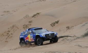 Carlos Sainz took his fifth stage win of the 2011 Dakar