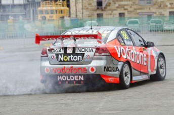Craig Lowndes launched the car by performing a spectacular burnout