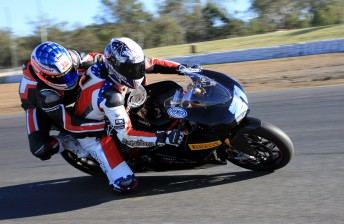 Troy Bayliss takes Michael Patrizi for some hot laps around Queensland Raceway