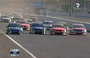 The calm before the storm – the V8 field roar four wide into turn one.