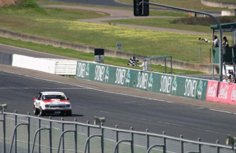 Jason Richards crosses the line to win the Group C Feature race