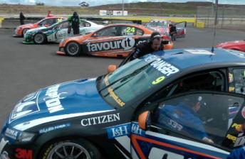 The pack of V8 Supercars at Calder Park Raceway