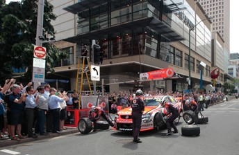 The TeamVodafone crew service the #88 Commodore in Brisbane's CBD