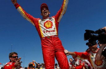 Helio Catroneves celebrates his first IndyCar win since October 2010