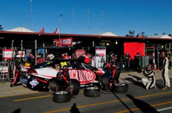 The Brad Jones Racing crew service the #14 Lockwood Racing Commodore of Fabian Coulthard