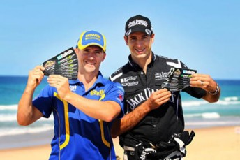 Lee Holdsworth and Rick Kelly with the Gold Coast Bulletin/Speedcafe.com bumper stickers