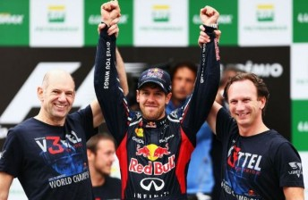 Chief designer Adrian Newey and team principal Christian Horner joined Vettel on the podium