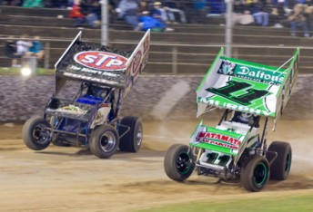 Peter Murphy (right) going wheel to wheel with Donny Schatz in NZ earlier this year