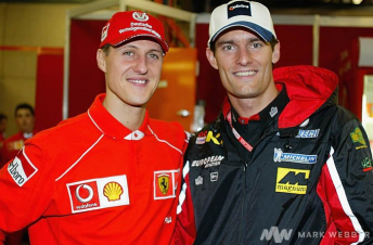 Mark Webber with Ferrari ace Michael Schumacher in 2002
