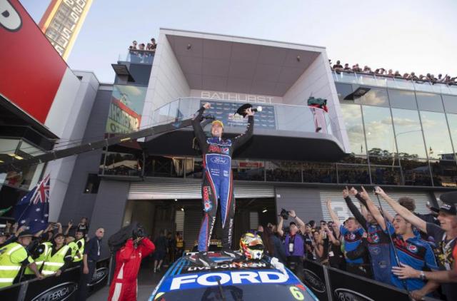 Chaz Mostert celebrates victory, scored alongside co-driver Paul Morris
