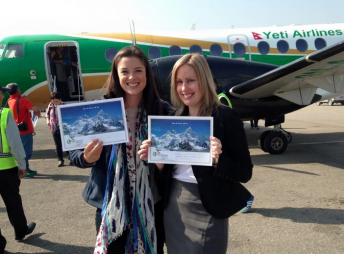 Reid and Dinsdale posing with photos of Nepal's Mount Everest on Friday. pic: Samantha Reid via Facebook