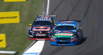 Whincup puts two wheels off track as the Ford blocks the line