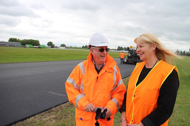 Manfeild chief executive Julie Keane and Higgins Group chairman and co-founder Sir Patrick Higgins visit the circuit during the resurfacing project
